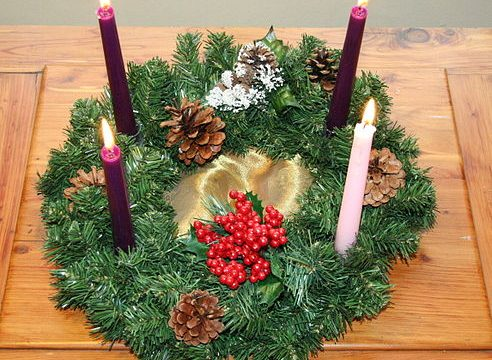 Why is the 3rd Candle pink in the Advent wreath?